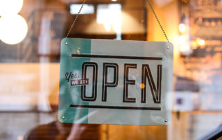 Small local business open sign reads, Yes, We Are OPEN.